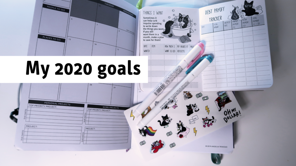 "a book and a planner with the text ""2020 goals"""