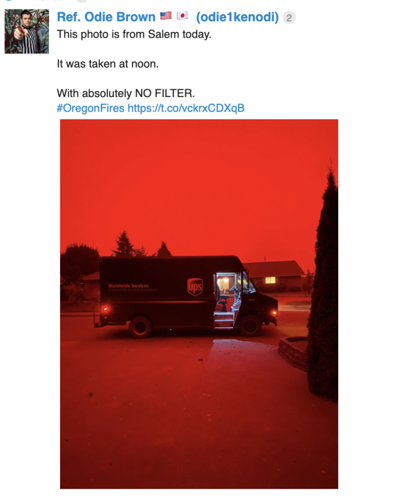 Shows a mail truck with a completely red sky