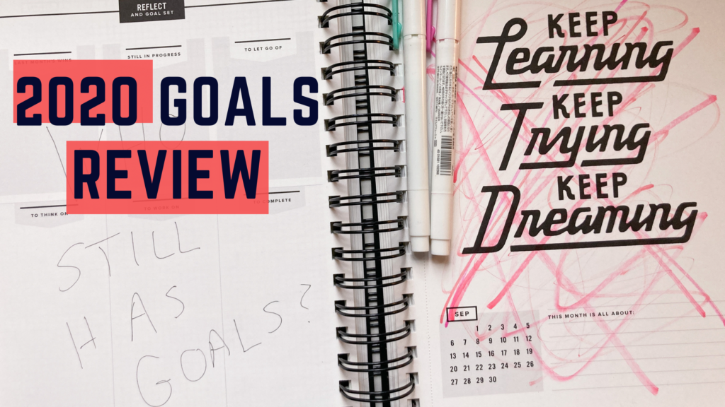 "shows a notebook with red marks scratched all over it and the words ""2020 goals review"""